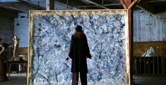 Julia Roberts, as Professor Katherine Ann Watson, standing in front of a Jackson Pollock painting, in the film  Mona Lisa Smile.
